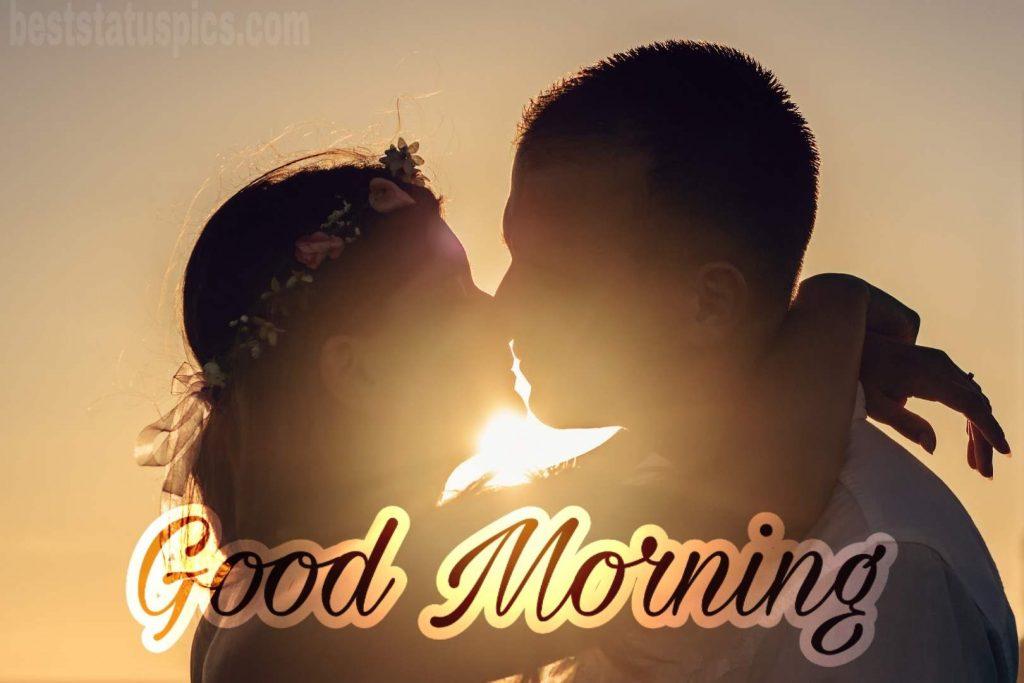 Romantic couple kisses good morning pic