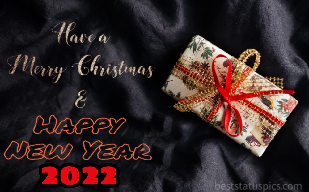 Merry Christmas and Happy New Year 2022 greetings with gift for friends